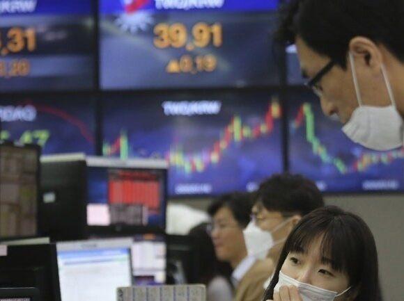 Μεικτά πρόσημα στην Ασία μετά τα ιστορικά υψηλά της Wall Street